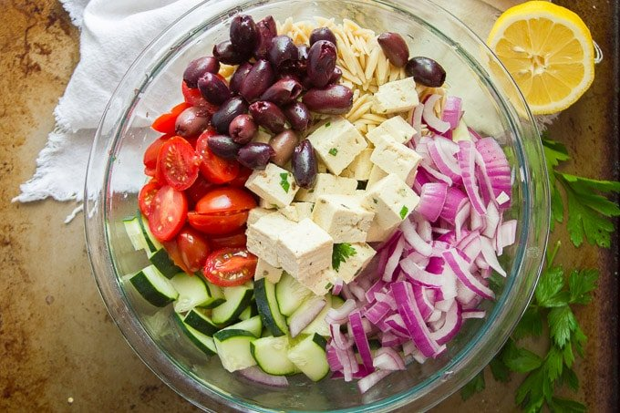 Ingredients for Making Vegan Greek Orzo Salad Arranged in a Bowl