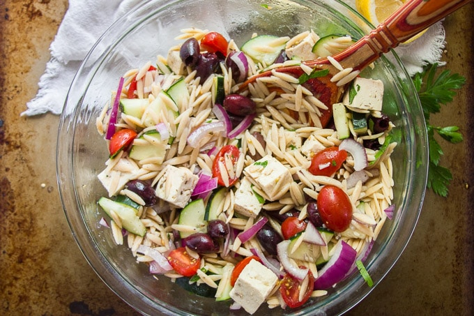 Overhead View of a Serving Bowl of Vegan Greek Orzo Salad