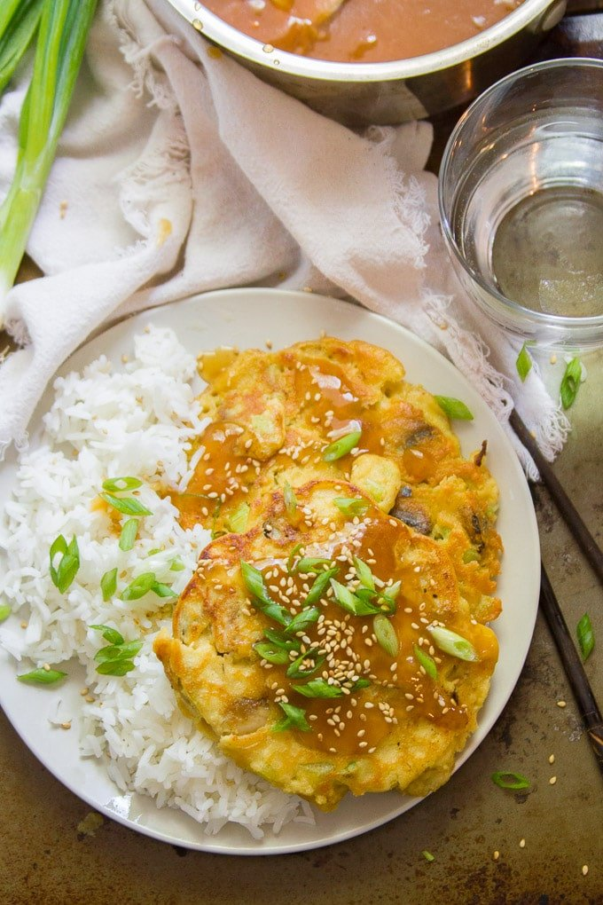 Vegan Egg Foo Young with Napkin, Chopsticks, and Water Glass