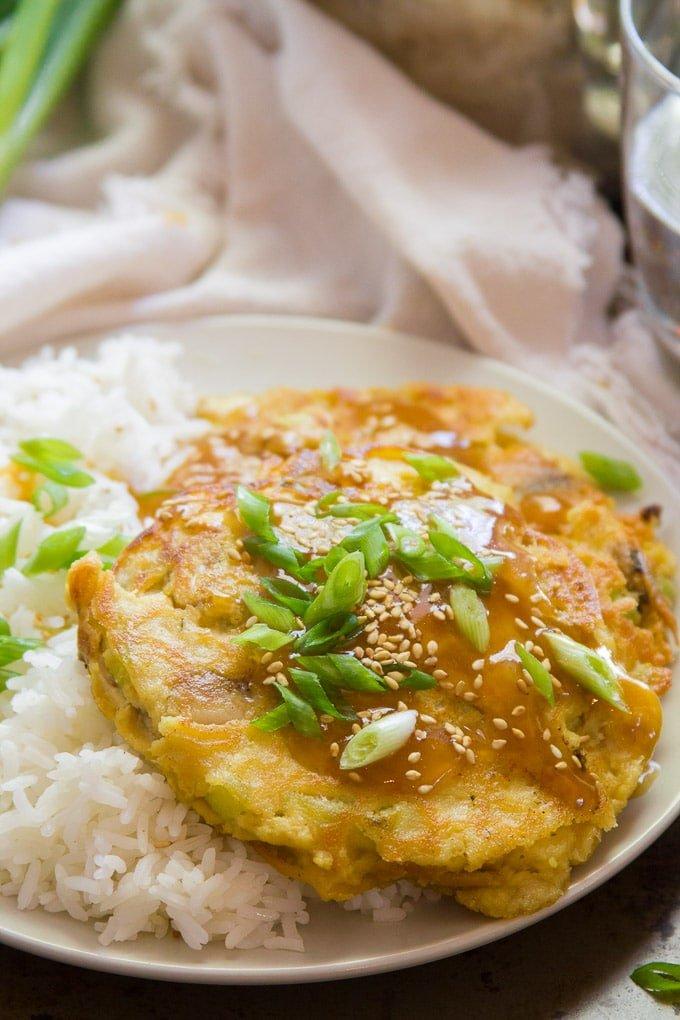 Close Up of Vegan Egg Foo Young Topped with Scallions and Sesame Seeds