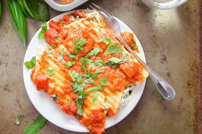 Overhead View of Vegan Manicotti with Blush Sauce and Kale on a Plate with Fork