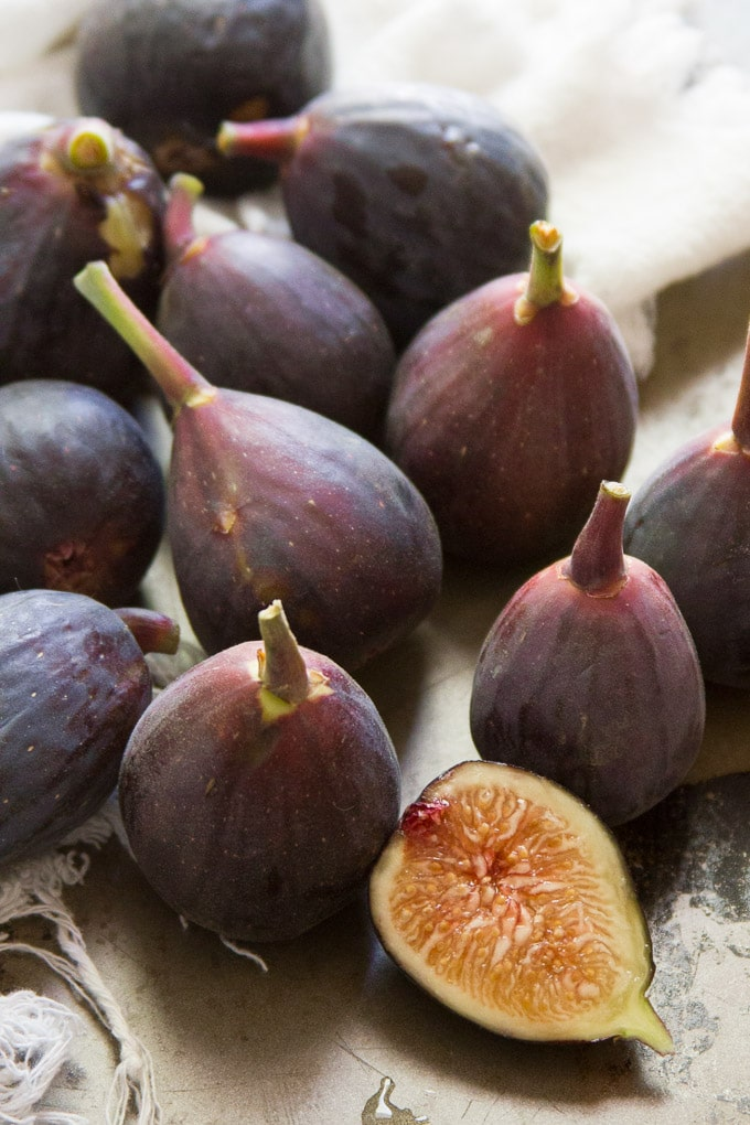 A Bunch of Figs Including one Cut in Half