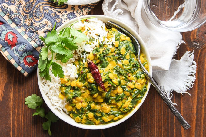 Overhead View of a Bowl of Spinach Dal with Rice and Fork