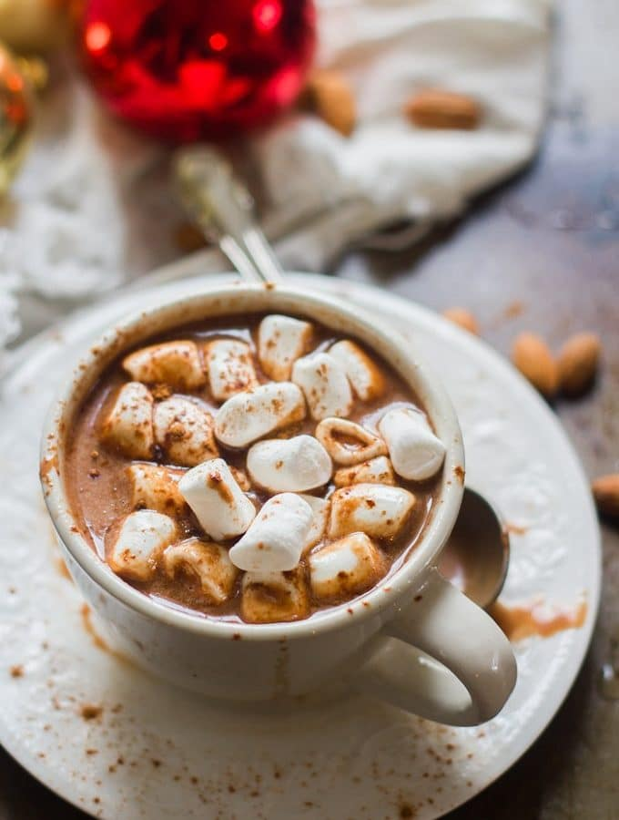 Cup of Vegan Hot Chocolate on a Saucer Topped with Marshmallows