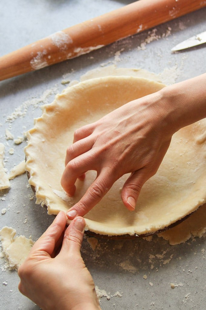 Hands Crimping the Edges of a Vegan Pie Crust