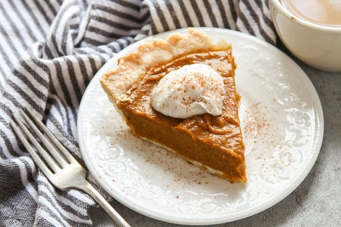 Close Up of a Slice of Vegan Pumpkin Pie on a Plate
