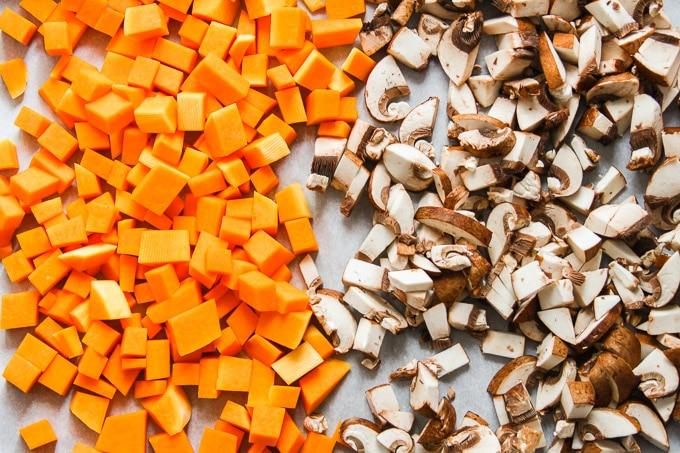 Butternut Squash and Mushrooms on a Baking Sheet for Making Vegan Vegetable Wellington