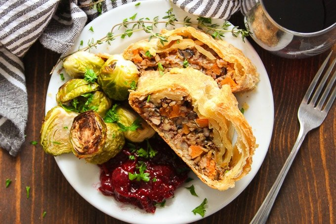 Vegan Vegetable Wellington on a Plate with Brussels Sprouts and Cranberry Sauce