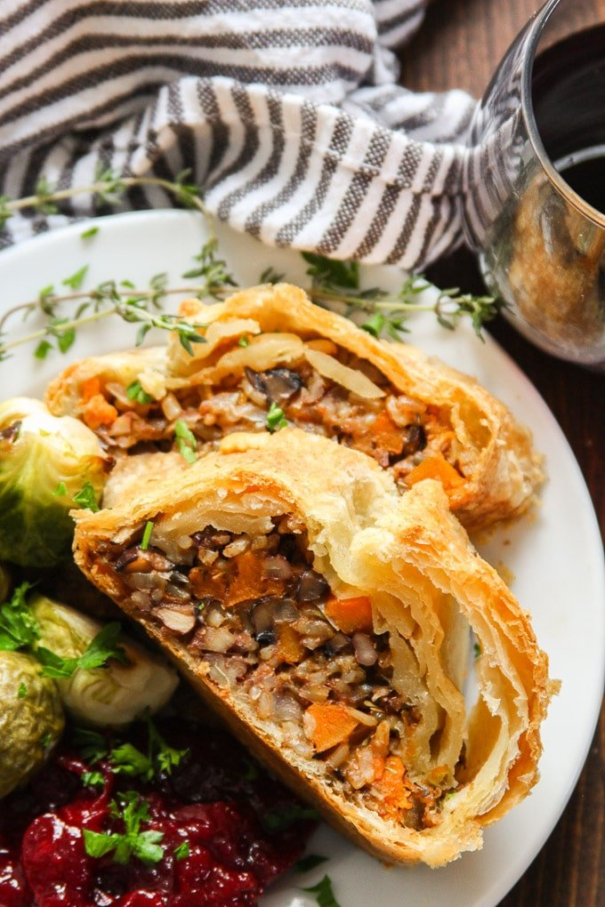 Close Up of Two Slices of Vegan Vegetable Wellington on a Plate