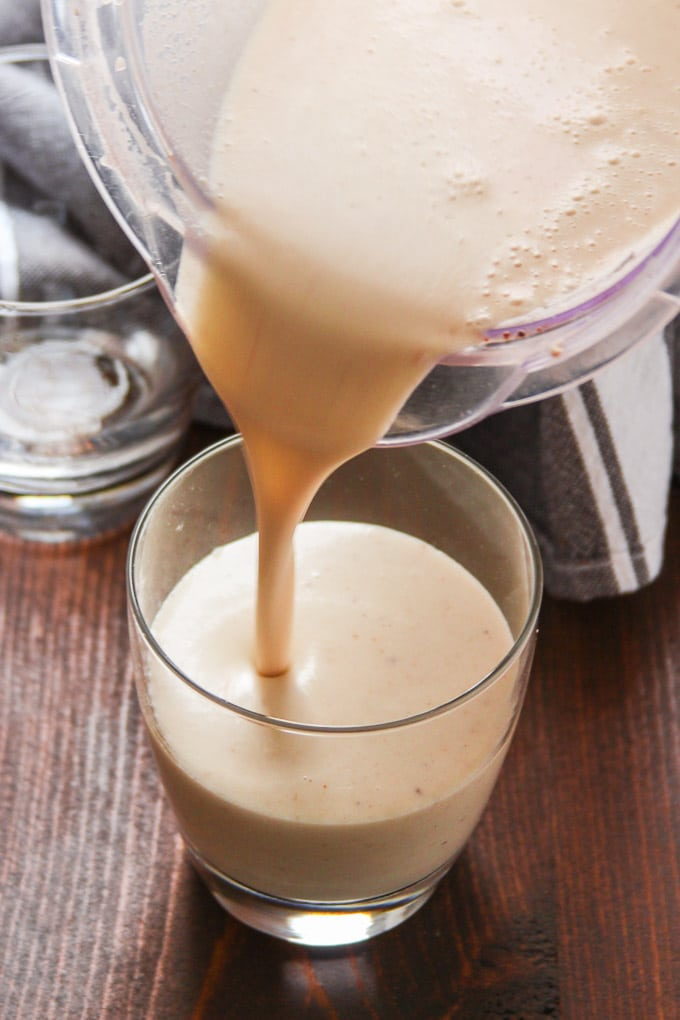 Vegan Eggnog Being Poured into a Glass