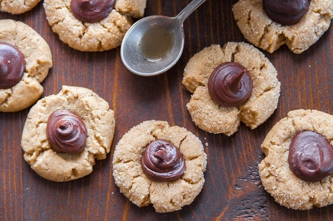 Overhead Close Up of Vegan Peanut Butter Blossoms on a Wooden Table