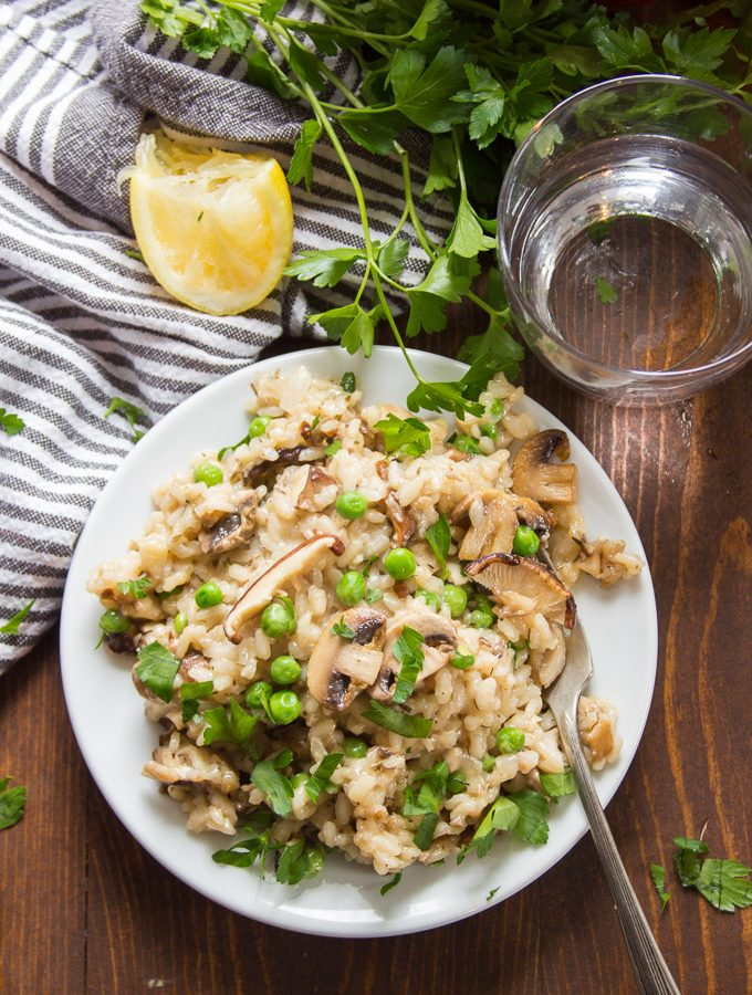 Overhead View of a Pot of Mushroom Risotto with Fork and Drinking Glass