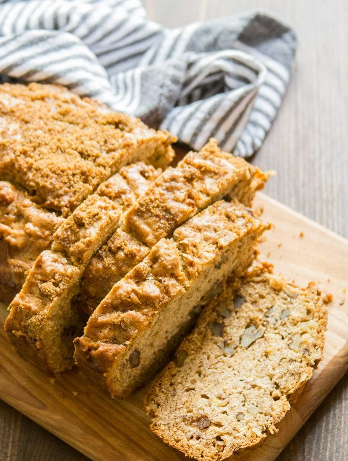Vegan Banana Bread on a Cutting Board with Napkin in the Background