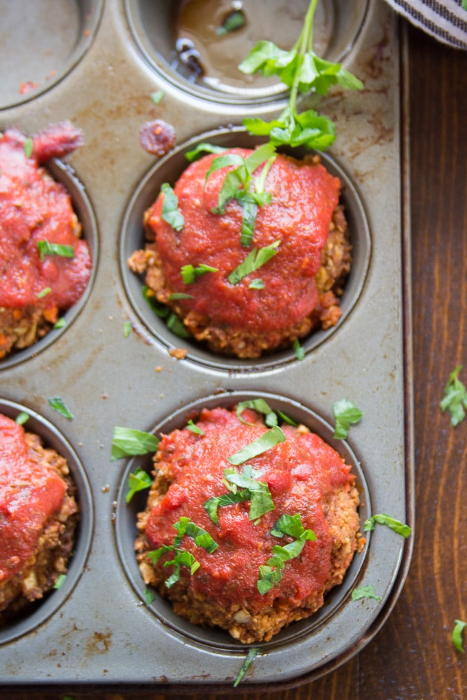 Four Italian-Style Vegan Meatloaf Muffins in a Tin with Parsley on Top