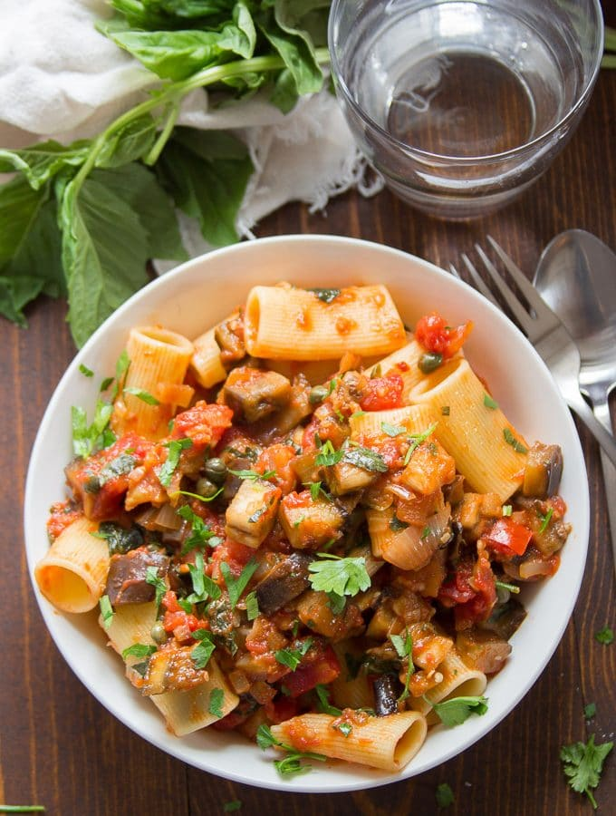 Spicy Eggplant Pasta in a Bowl Topped with Fresh Basil & Parsley