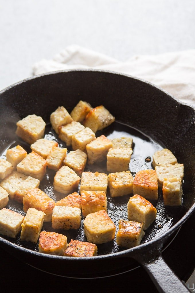 Tempeh Cubes Frying in a Skillet