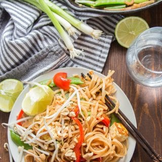 Vegan Pad Thai on a Plate with Chopsticks and Water Glass