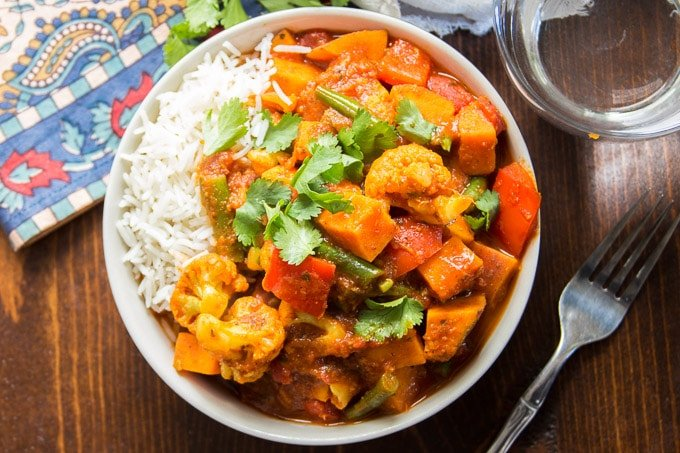 Bowl of Sweet Potato & Vegetable Vindaloo with Rice and Cilantro