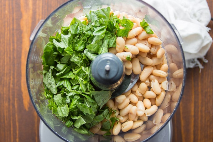 Ingredients For Making White Bean Basil Hummus in a Food Processor Bowl