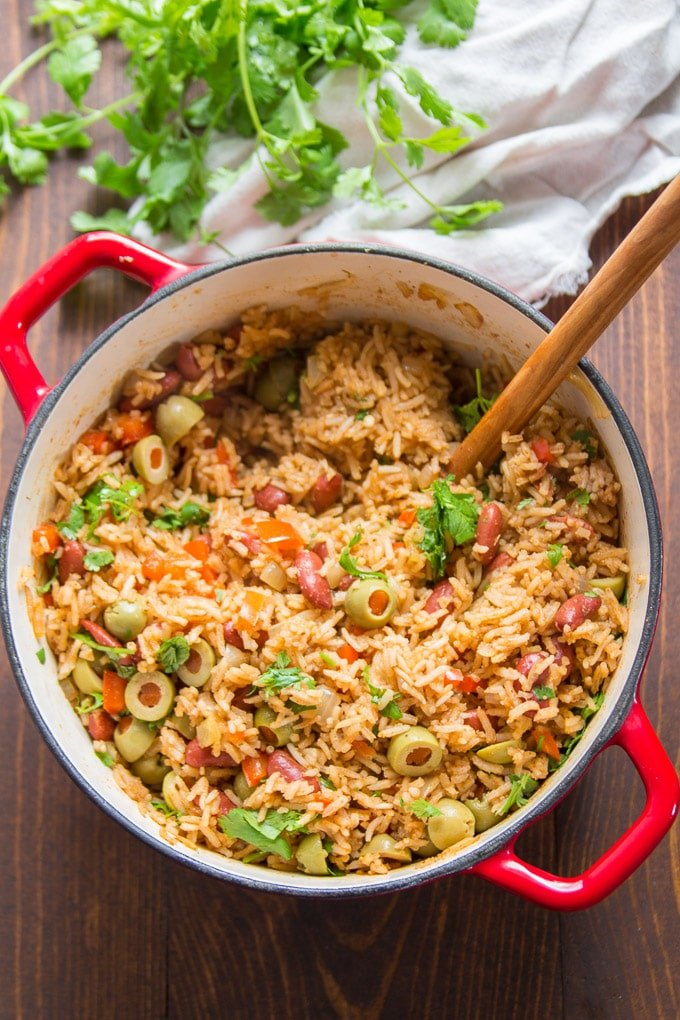 A Pot of Spanish Rice & Beans with Wooden Spoon
