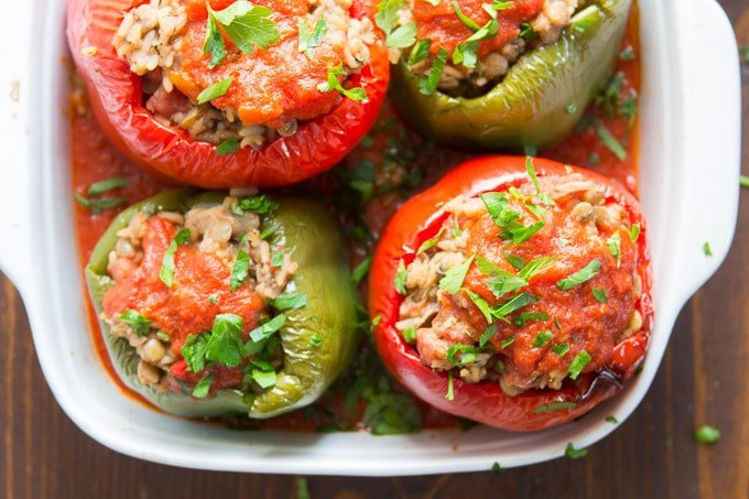 Four Vegan Stuffed Peppers in a Baking Dish