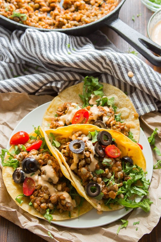 Vegan Lentil Tacos on a Plate with Skillet and Napkin in the Background