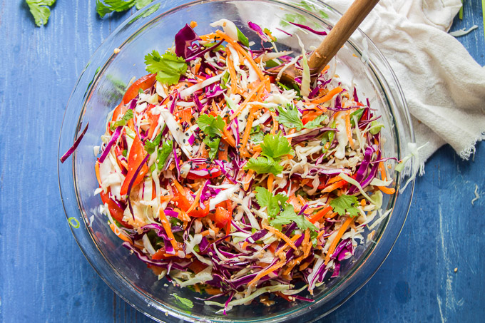 Bowl of Asian Slaw with Wooden Spoon