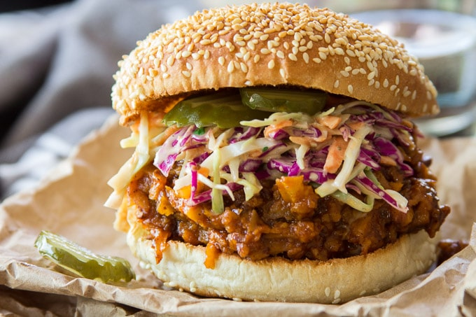 "Close Up of a Vegan Barbecue ""Beef"" Sandwich Topped with Coleslaw"