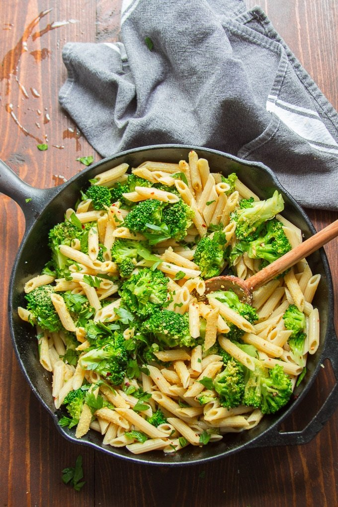 Skillet Filled with Broccoli Pasta and Serving Spoon