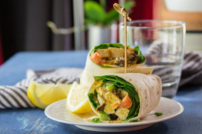 Curried Tofu Salad Wrap on a Plate with Lemon Wedges