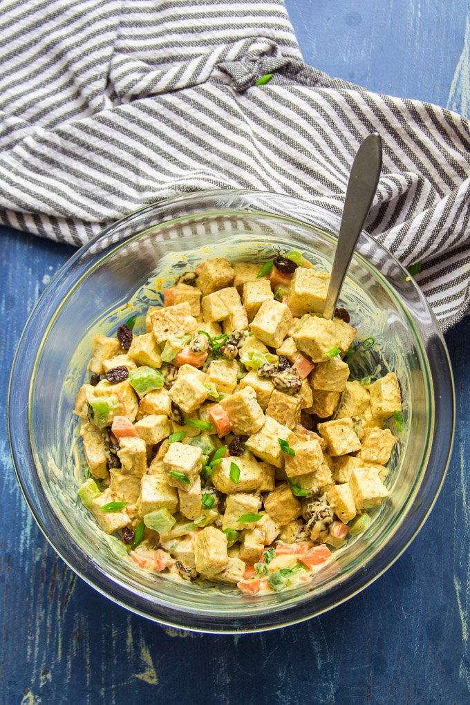 Curried Tofu Salad in a Glass Bowl with Spoon