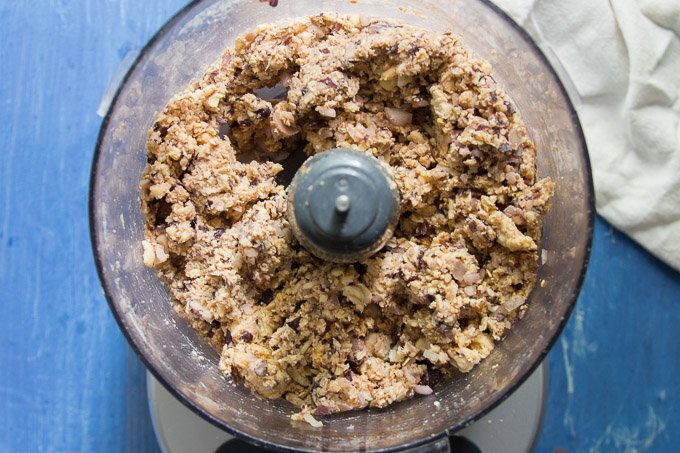 Teriyaki Tempeh Burger Ingredients in a Food Processor Bowl Just After Blending