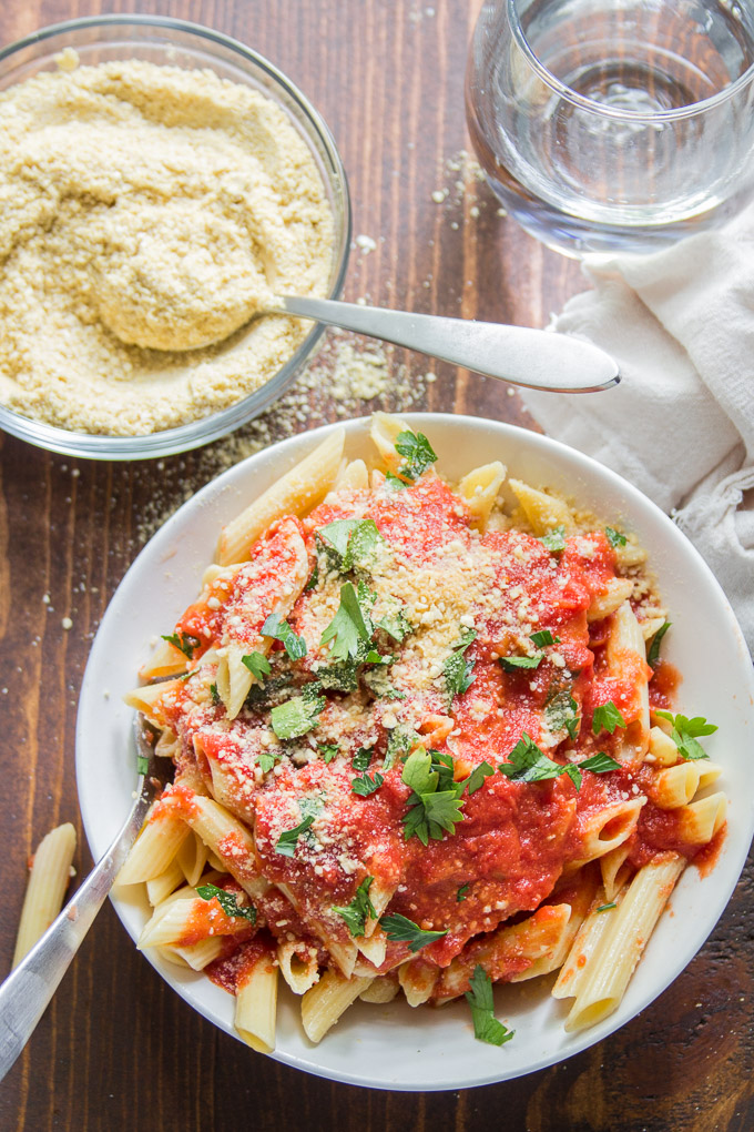 Bowl of Pasta with Tomato Sauce and Vegan Parmesan Cheese on Top