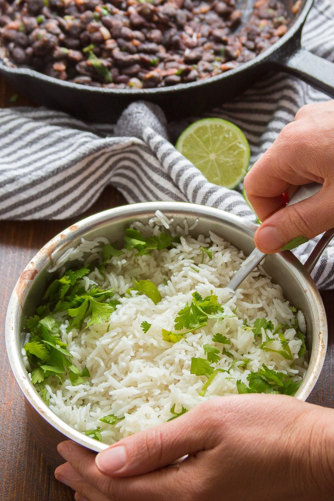 Hand Stirring a Pot of Cilantro Lime Rice