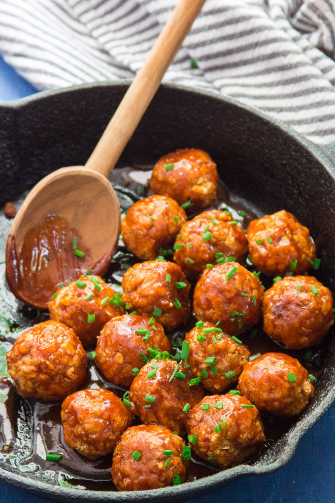 Firecracker Chickpea Meatballs in a Skillet with Wooden Spoon