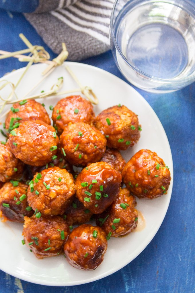 A Plate of Firecracker Chickpea Meatballs on a Blue Background