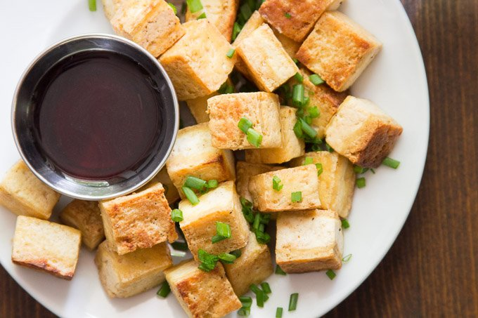 Crispy Salt & Vinegar Tofu on a Plate with a Side of Malt Vinegar