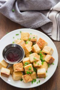 Crispy Salt & Vinegar Tofu on a Plate Topped with Chives