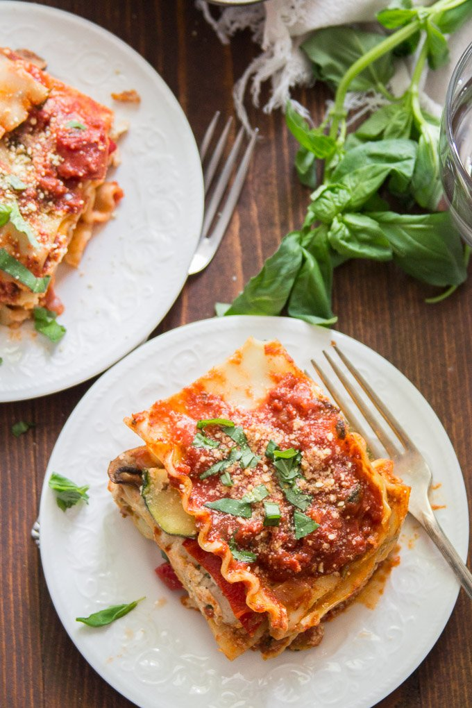 Two Plates of Vegan Lasagna on a Wooden Table