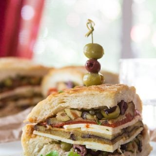 Vegan Muffaletta Slice Skewered with Olives