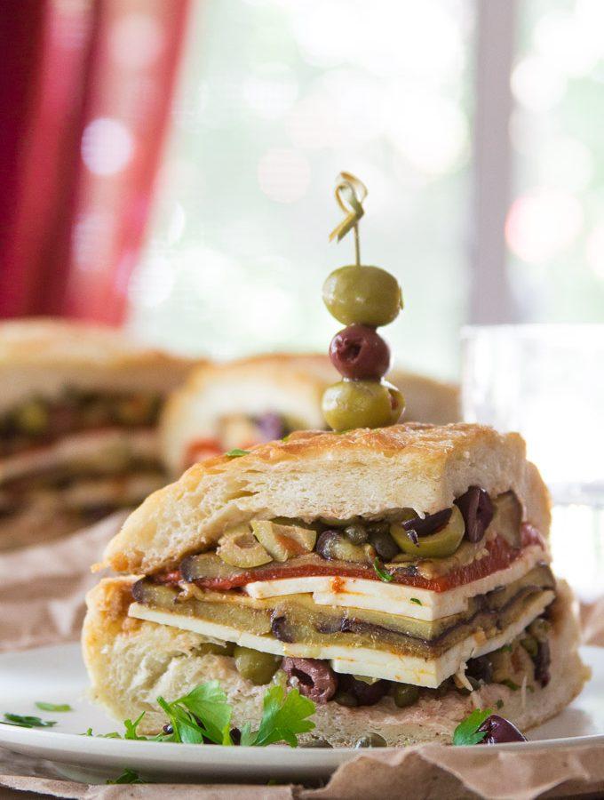 Vegan Muffaletta Slice Skewered with Olives