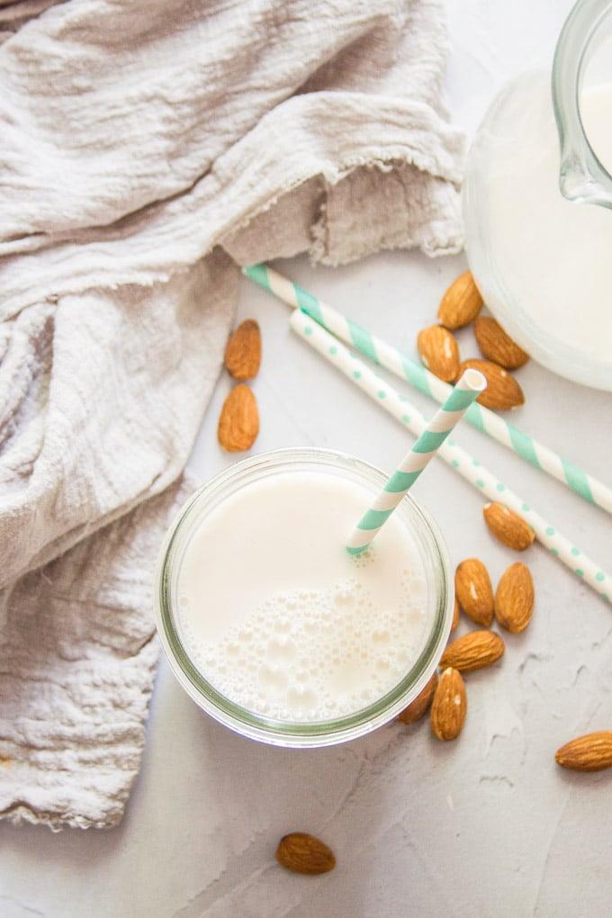 Glass of Almond Milk with a Striped Straw