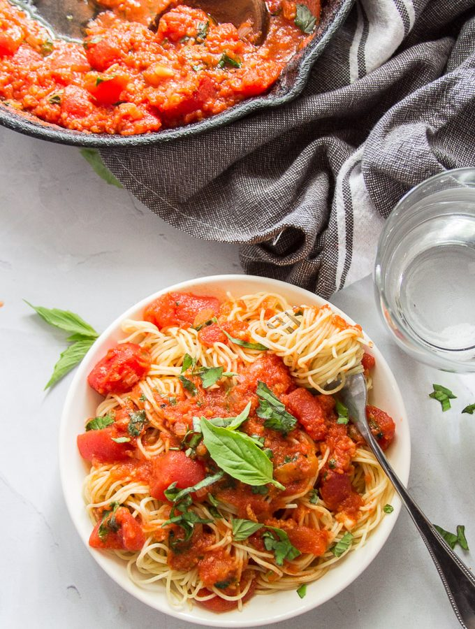 Bowl of Pasta Pomodoro with Pasta Wrapped Around a Fork