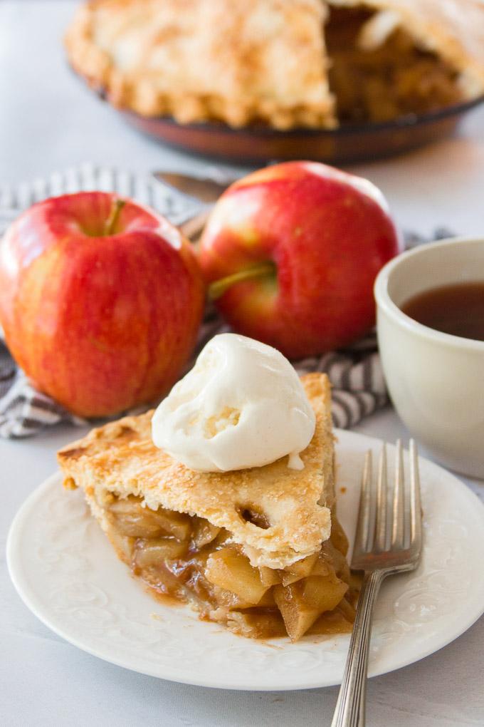 A Slice of Vegan Apple Pie a la Mode on a Plate
