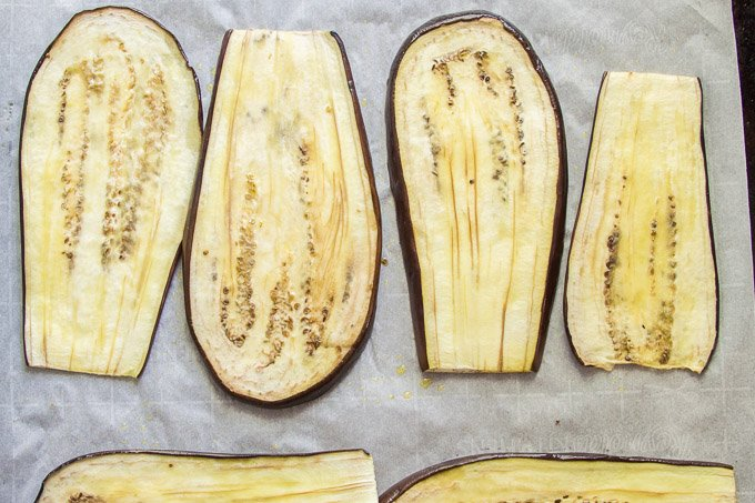 Roasted Eggplant Slices on a Baking Sheet
