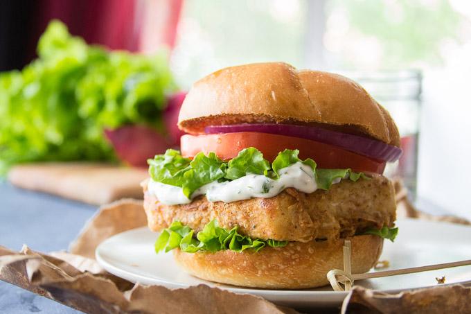 "Vegan ""Fish"" Sandwich on a Bun with Tartar Sauce, Lettuce, Tomato and Onion"