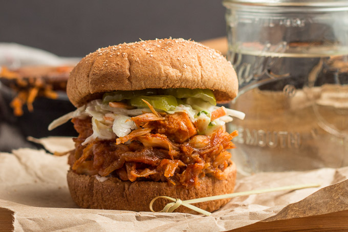 Jackfruit Pulled Pork Sandwich Topped with Coleslaw and Pickles
