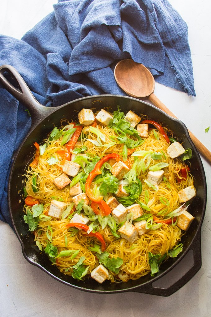 Singapore Noodles in a Cast Iron Skillet with Wooden SPoon