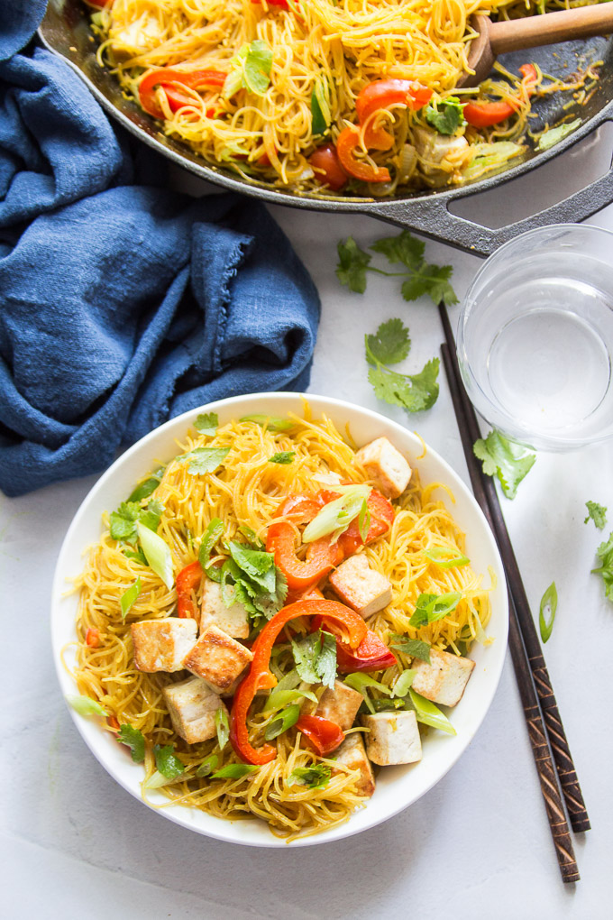 Bowl of Vegan Singapore Noodles with Chopsticks and Water Glass