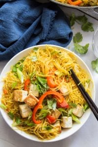 Bowl of Singapore Noodles with a Cluster of Noodles Wrapped Around a Pair of Chopsticks